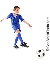 Kicking a soccer ball - A boy kicks a soccer ball. Motion in...