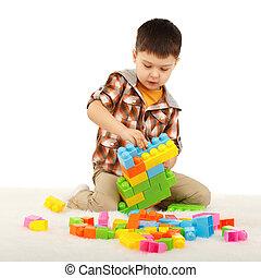 kicsi fiú, játék, noha, tervező, a padlóra