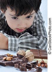 Kid and chocolate nut