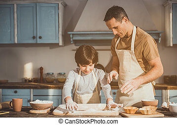 Kid and dad making dish for dessert