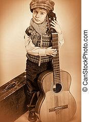 kid and guitar