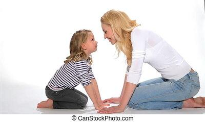 Kid and mother do eskimo kiss