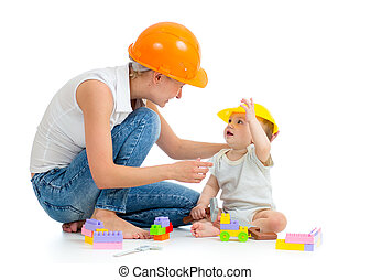 kid and mother play with building blocks toy