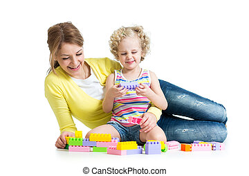 kid and mother playing together with construction set toy