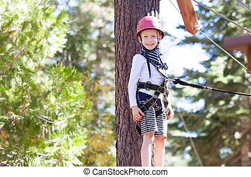 kid at adventure park - positive little boy at outdoor ...