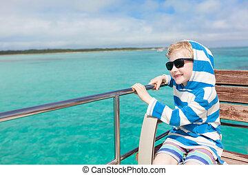 kid at the boat