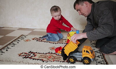 kid boy and his dad playing
