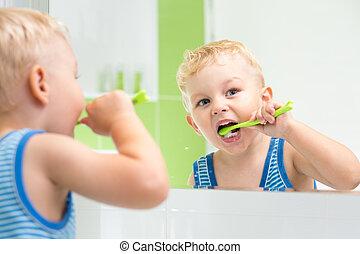 kid boy brushing teeth