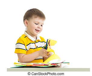 kid boy cut paper