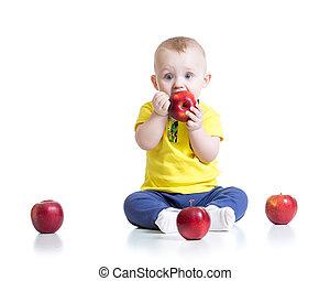 Kid boy eating apple, isolated on white