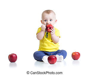 Kid boy eating apple, isolated on white