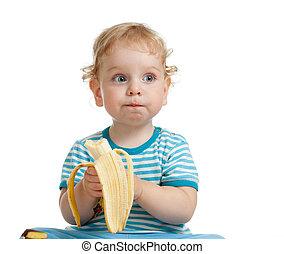 Kid boy eating banana isolated