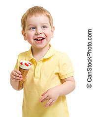 Kid boy eating ice cream isolated on white studio shot