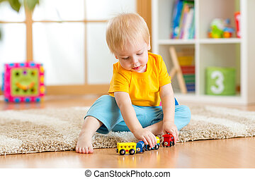 kid boy playing with toys indoor - kid boy playing toys at...