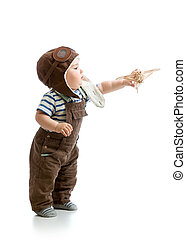 Kid boy playing with wooden plane