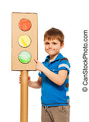 Kid boy studying road traffic regulations, pointing to the...