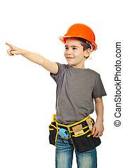 Kid boy with helmet pointing away