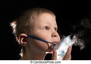 Kid breathing through nebulizer mask
