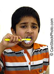 Kid Brushing his teeth - a kid diligently brushing his teeth