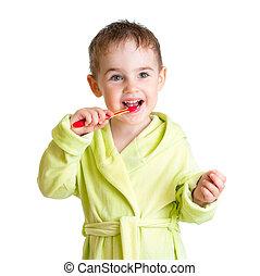 kid brushing teeth isolated on white