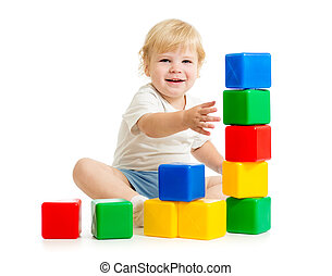 kid building tower using colorful blocks