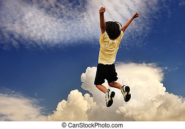 Kid celebrates, high jumping up, successful winner