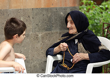 Kid chatting with granny - Little kid chatting with old...