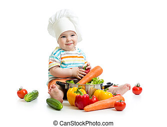 kid chef with healthy  food vegetables