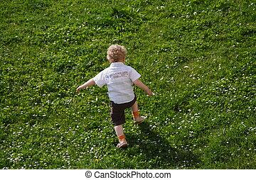 kid climbing hill