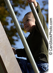 Kid Climbing Up the Slider