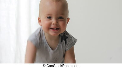 Kid crawls to camera smiles and can see six teeth - baby boy...