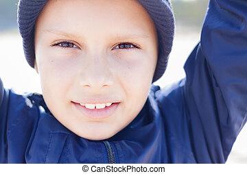 kid cute 9 years look camera close up outdoor