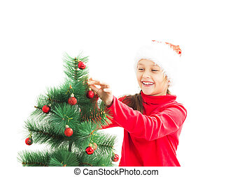 kid decorate the Christmas tree Christmas toys on a white backgr