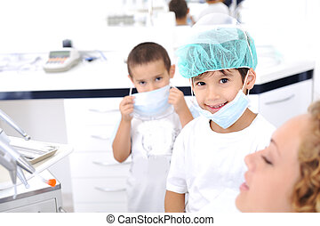 Kid Dentist's teeth checkup, series of related photos - Kid...