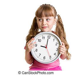 Kid displaying nine o'clock time in studio isolated