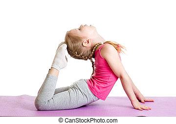 Kid doing fitness exercises on mat. Isolated on white.