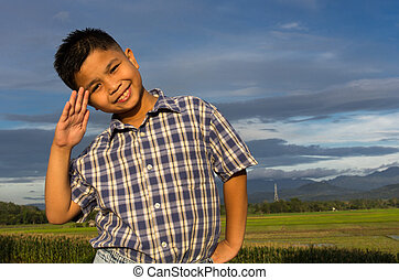 Kid doing hand salute for stock images