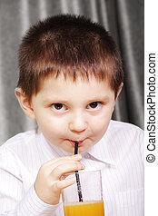Kid drinking juice