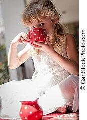 kid drinking tea