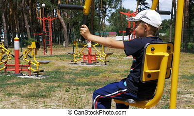 Kid Engaged on Street Sports Training Equipment