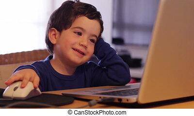 Kid enjoy E-learning - Shot of Kid enjoy E-learning