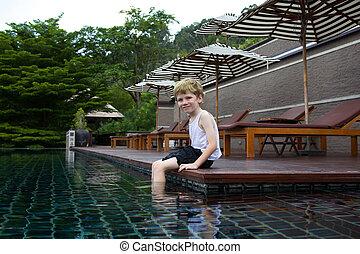 Kid enjoying the pool.