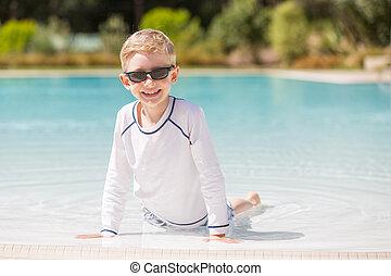 kid enjoying the pool