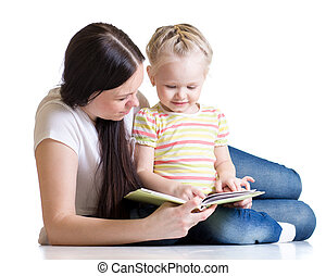 kid girl and her mom read a book