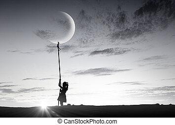 Kid girl catching moon