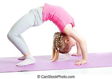 kid girl doing gymnastics on fitness mat