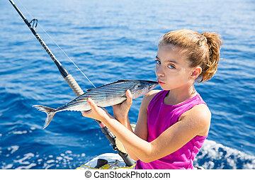 kid girl fishing tuna bonito sarda kissing fish for release due little size
