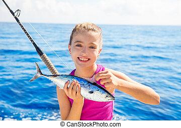 Kid girl fishing tuna little tunny happy with fish catch -...