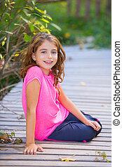 Kid girl in autumn smiling with braces teeth apparatus - Kid...
