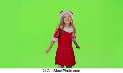 Kid girl in red New Year costumes are dancing. Green screen. Slow motion